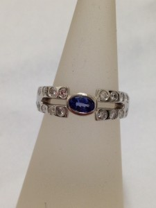Platinum ring with a lovely tanzanite and diamonds from the customers grandmothers ring.