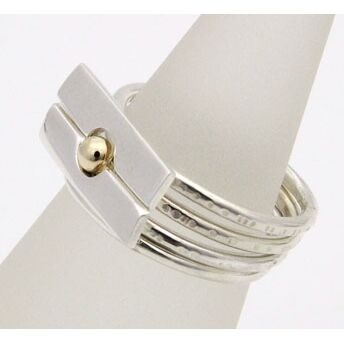 Four Silver Stacking Rings with Gold