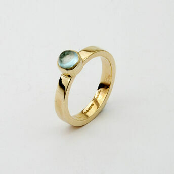 Gold Ring with Light Round Stone